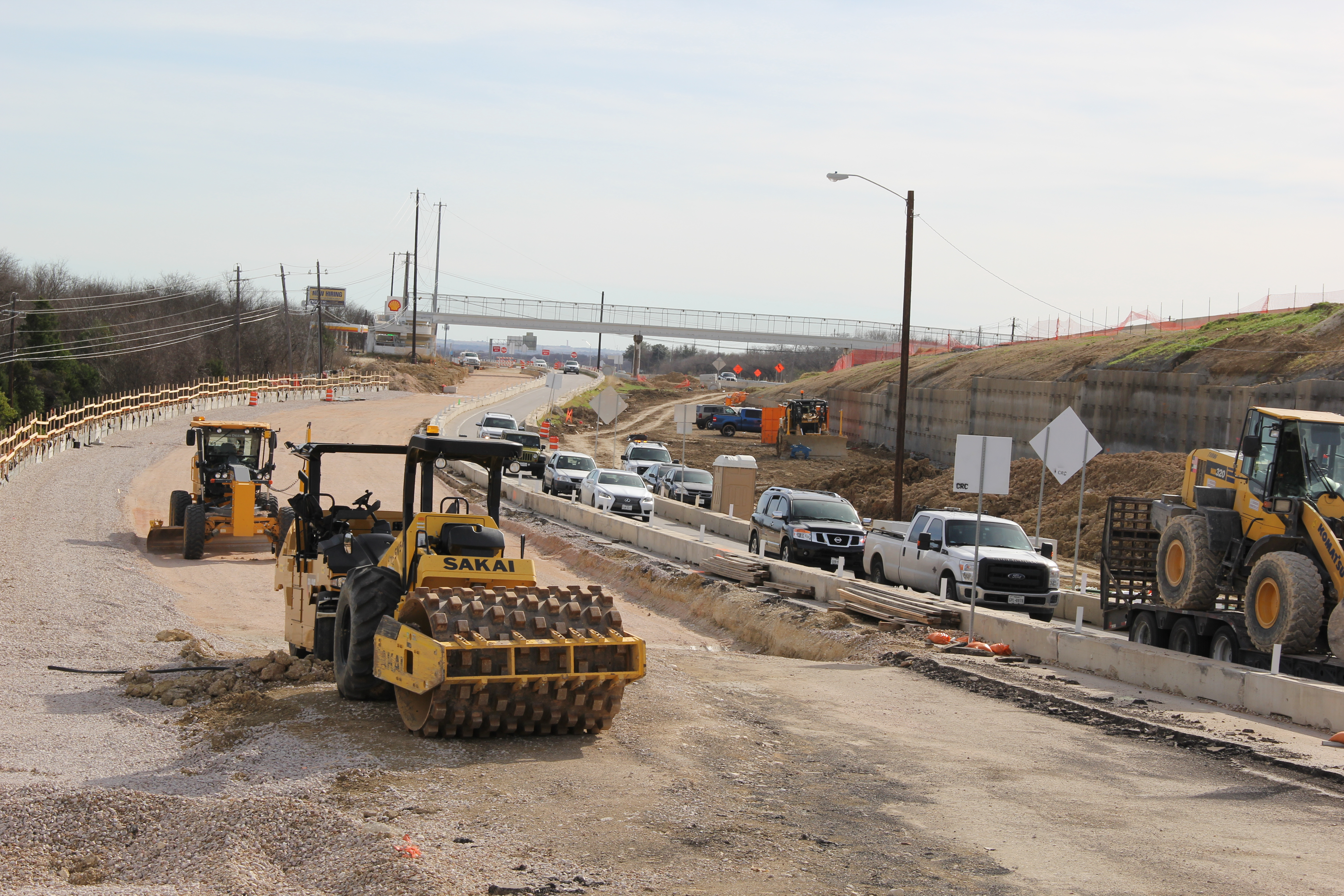 Retaining wall and roadway base work on northbound general purpose lanes at Springdale/Manor Road
