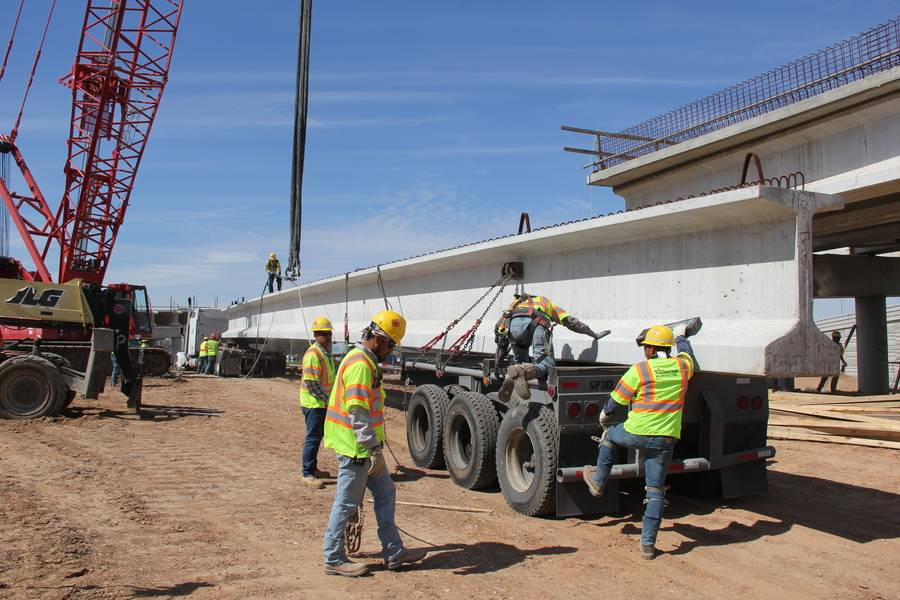Crews setting bridge beams near the Colorado River